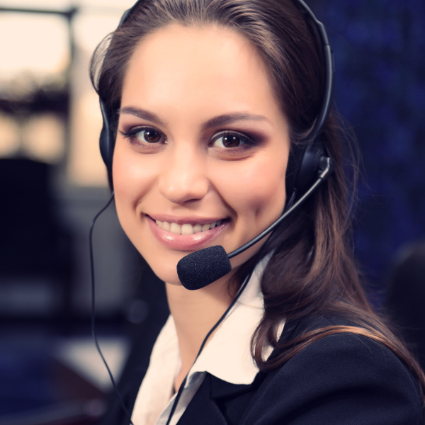 Smiling female customer service support representative wearing a headset